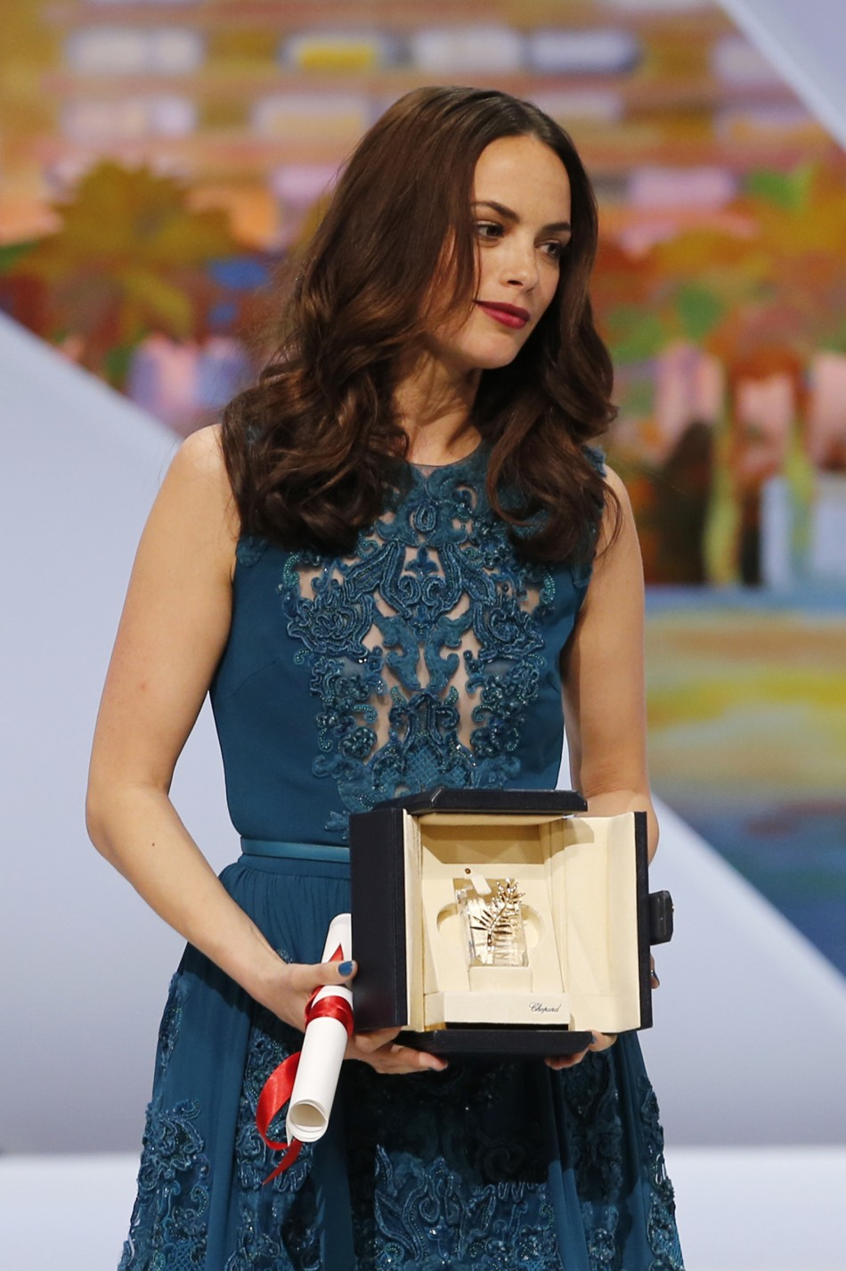 Actress Berenice Bejo, Best Actress award winner for her role in the film Le Passe The Past, poses on stage during the closing ceremony of the 66th Cannes Film Festival in Cannes May 26, 2013.