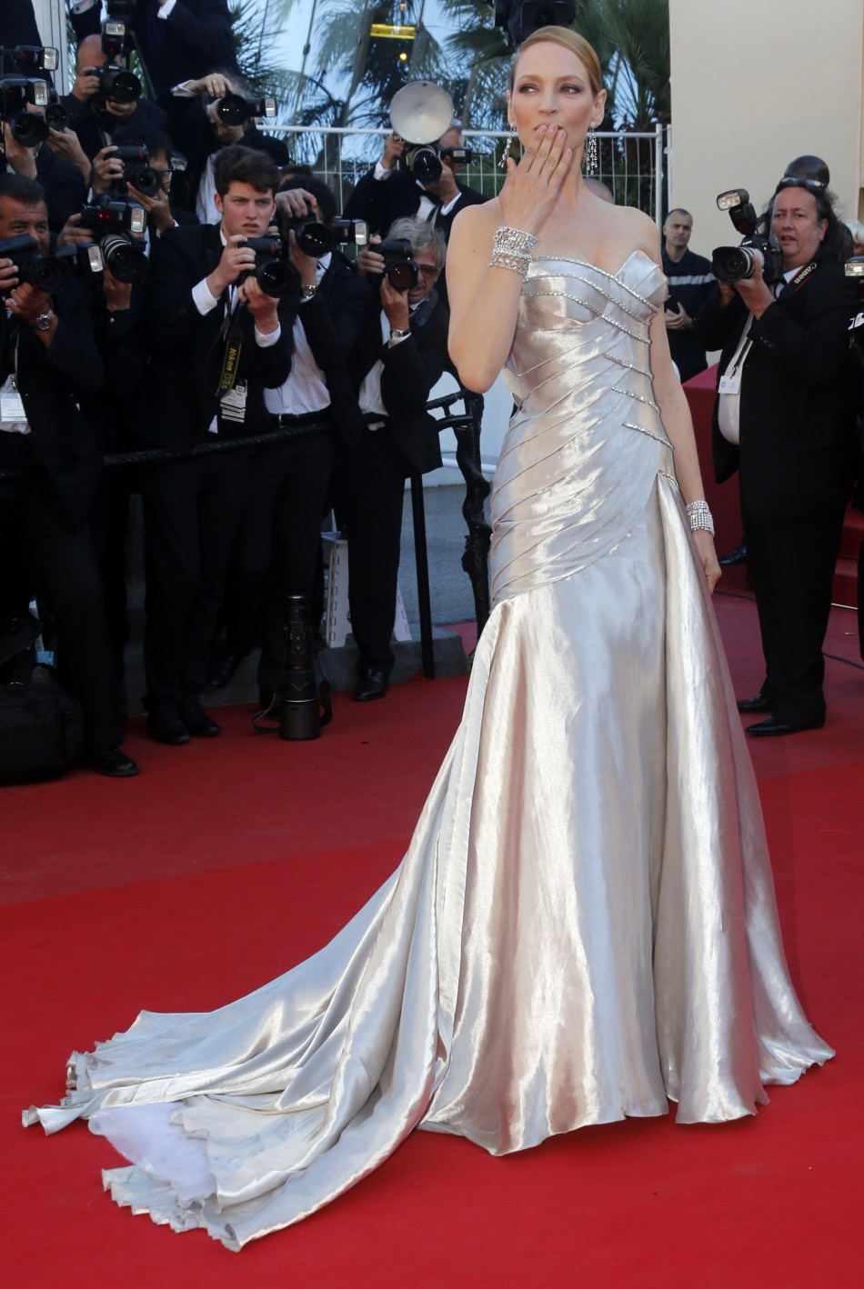 Actress Uma Thurman poses on the red carpet as she arrives at the closing ceremony of the 66th Cannes Film Festival in Cannes May 26, 2013.
