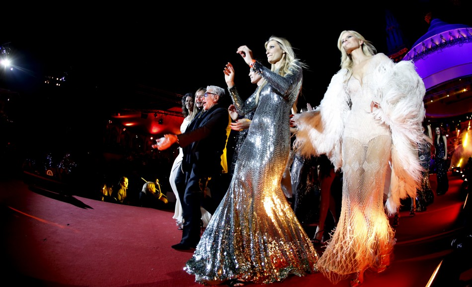 Italian fashion designer Roberto Cavalli C arrives with models for the opening ceremony of the 21st Life Ball in Vienna