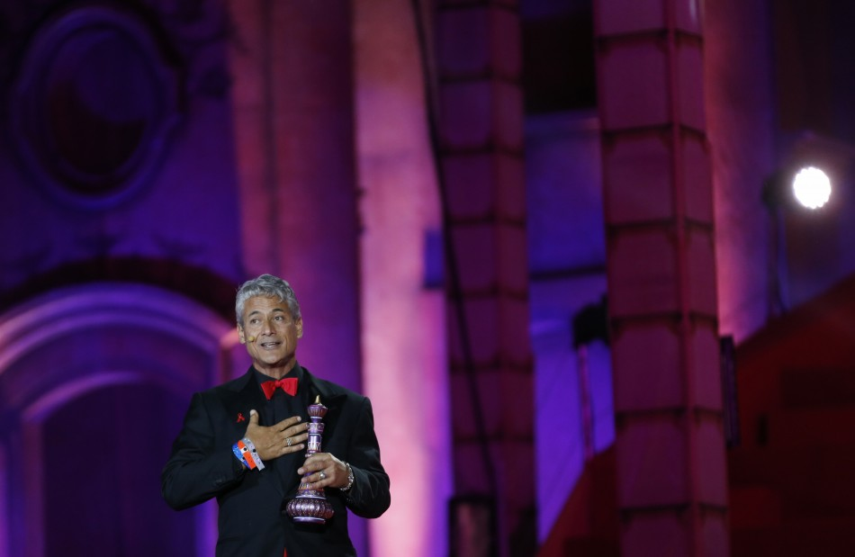 Former U.S. Olympic diver Greg Louganis performs during the opening ceremony