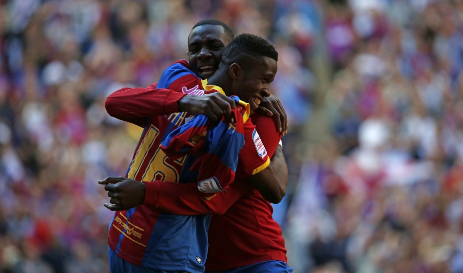 Zaha celebrates in yesterday's play off victory. (Reuters)