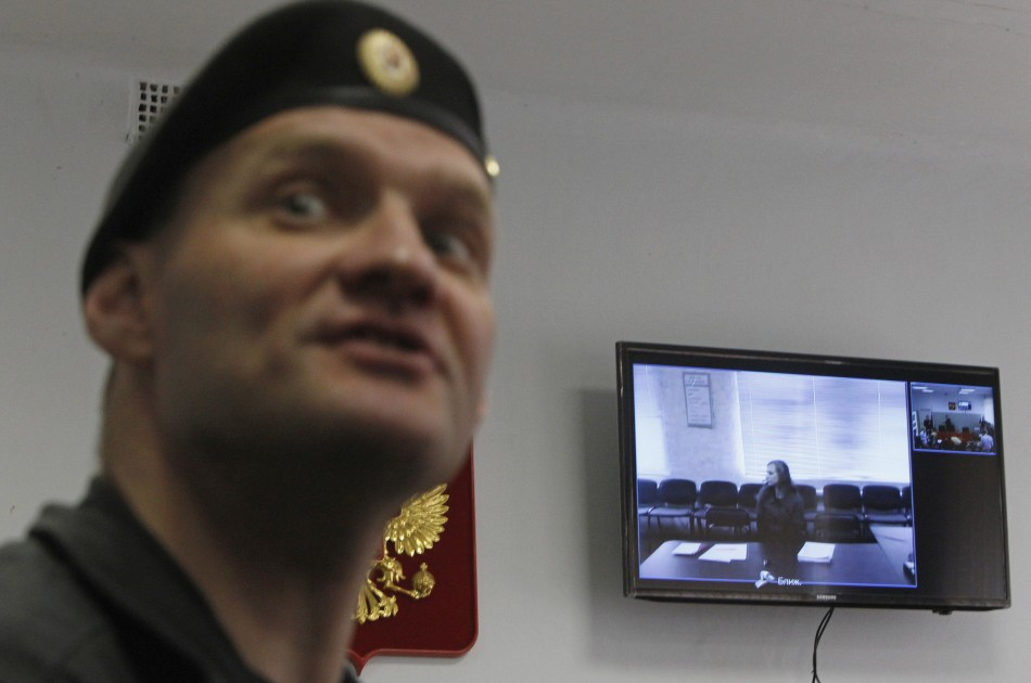 Jailed Pussy Riot punk rock group member Maria Alyokhina is seen on a monitor, as she takes part in a video conference from the penal colony