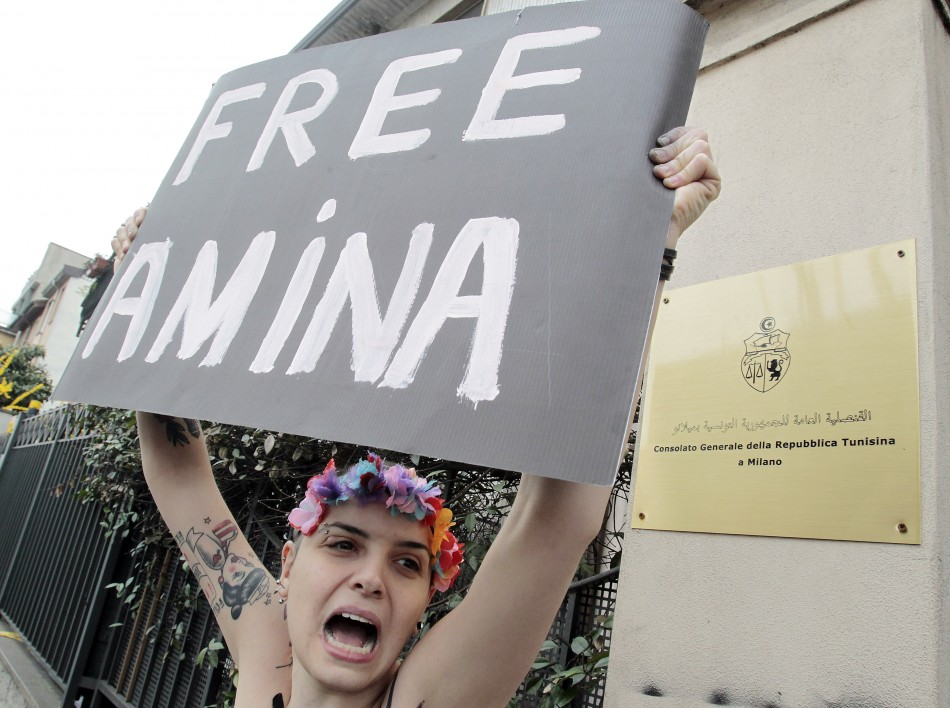 An activist from women's rights group Femen takes part in a protest in front of the Consulate General of the Tunisian Republic in Milan