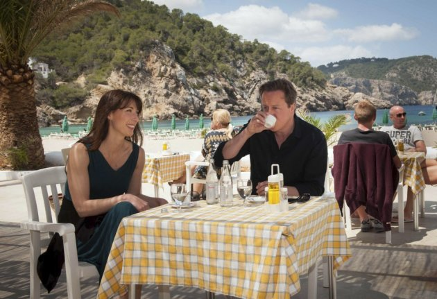 Life's a beach: PM Cameron sips a continental coffee on Ibiza