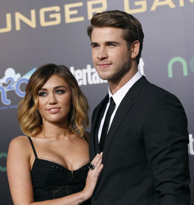 Liam Hemsworth poses with actress Miley Cyrus