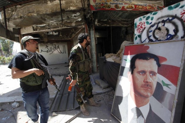 Security personnel loyal to Syria's President Bashar al-Assad