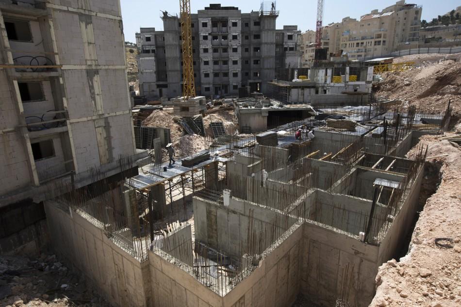 Labourers work on a construction site in a Jewish settlement near Jerusalem