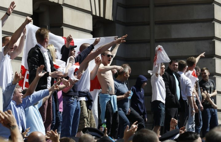 English Defence League demonstrators shout and gesture during a protest in Whitehall (Reuters)