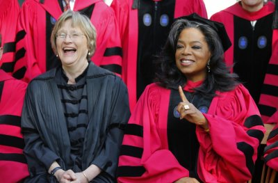 Media mogul Oprah Winfrey R sits with Harvard President Drew Faust before the 362nd Commencement ceremony at Harvard University in Cambridge, Massachusetts May 30,