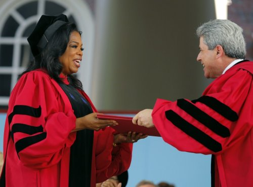 Oprah Winfrey accepts an honorary Doctor of Laws degree from Marc Goodheart (R), Vice President and Secretary of the University following in the footsteps of Harry Potter author JK Rowling and Microsoft founder Bill Gates