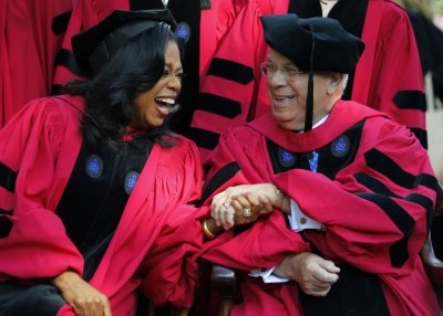 Oprah Winfrey L talks to Boston Mayor Thomas Menino before the 362nd Commencement ceremony at Harvard University in Cambridge, Massachusetts May 30, 2013