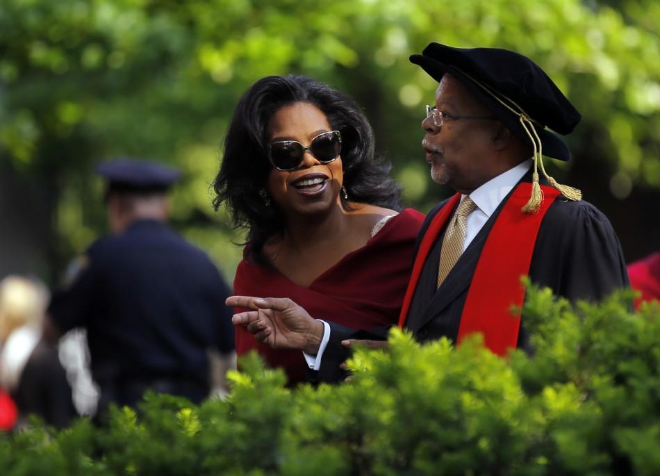 Oprah Winfrey and professor Henry Louis Gates Jr. R arrive for Harvard Universitys 362nd Commencement ceremony in Cambridge, Massachusetts