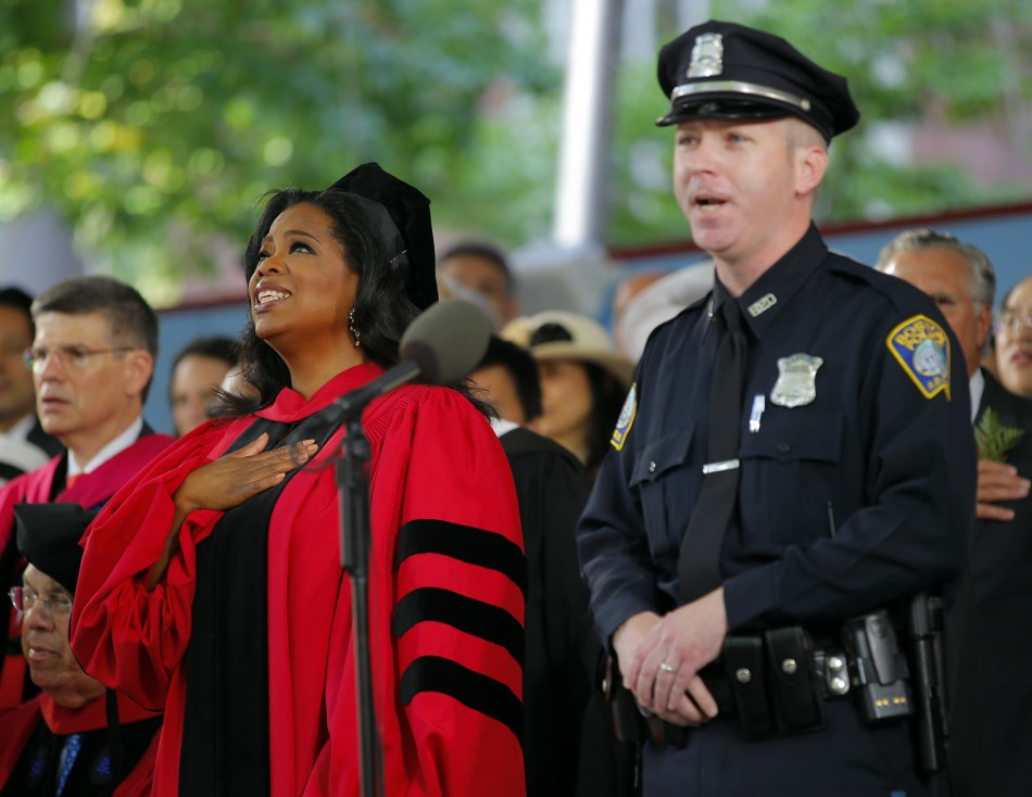 Oprah Winfrey stands for the United States national anthem during Harvard Universitys 362nd Commencement ceremony in Cambridge, Massachusetts