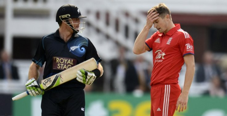 Martin Guptill (L) and Chris Woakes