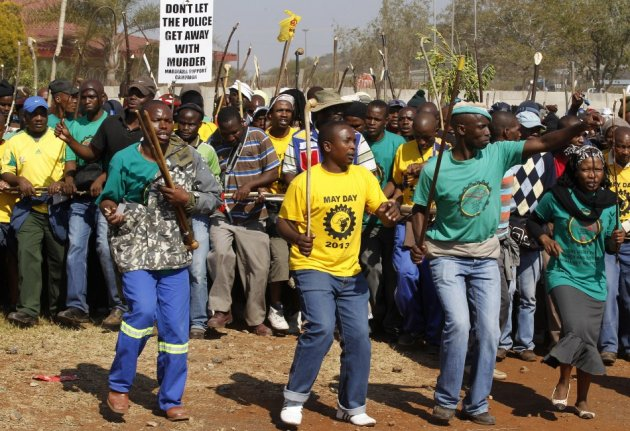 Members of the mining community march during a strike at Lonmin's Marikana platinum mine in Rustenburg, 100 km (62 miles) northwest of Johannesburg, May 15, 2013. (Photo: Reuters)