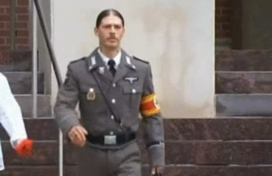 Heath Campbell outside the courtroom in his Nazi uniform (NBC10)
