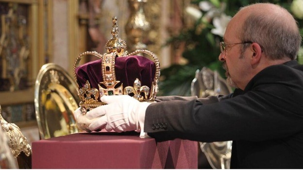 The St Edward's Crown is placed with care PIC: Westminster Abbey