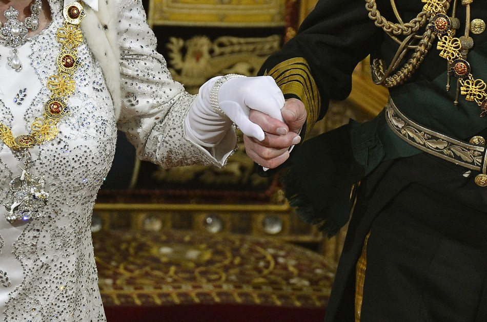 Prince Philip take's the Queen's hand at her speech at Westminster