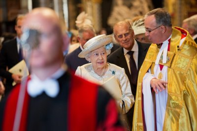 Queen Elizabeth 3rd R and Prince Philip 2nd R are accompanied by the Dean of Westminster, John Hall R, as they attend a service celebrating the 60th anniversary of the Queens coronation at Westminster Abbey in London June 4, 2013.