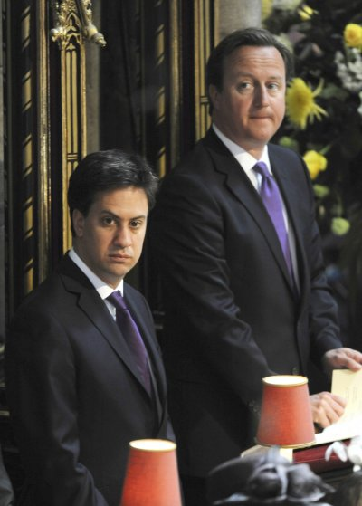 Prime Minister David Cameron R and opposition Labour Party leader Ed Miliband attend a service celebrating the 60th anniversary of Queen Elizabeths coronation at Westminster Abbey in London June 4, 2013.