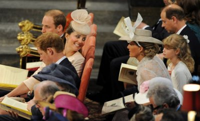 Catherine, Duchess of Cambridge L CENTRE smiles as she sits between her husband Prince William L TOP and Prince Harry during a service celebrating the 60th anniversary of Queen Elizabeths coronation at Westminster Abbey in London June 4, 2013.