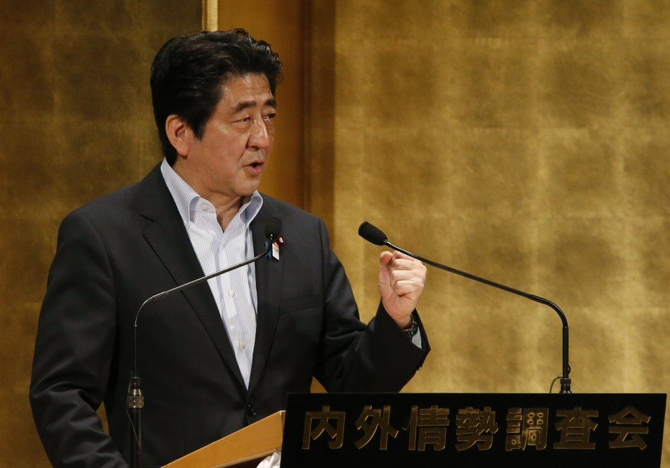 Japan's PM Abe delivers a speech at a seminar in Tokyo