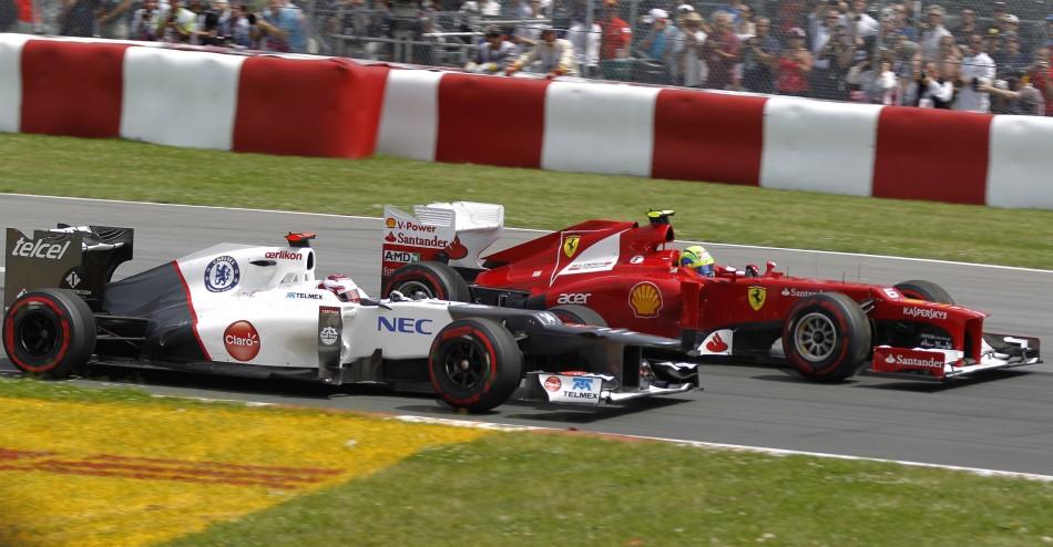 Kamui Kobayashi [Sauber] and Felipe Massa [Ferrari]