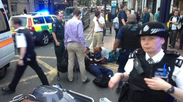 Suspect lies on ground aftr Selfridges raid PIC: Michael Carrozo