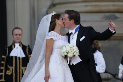 Swedens Princess Madeleine kisses U.S.-British banker Christopher ONeill outside the royal church after their wedding ceremony in the royal castle in Stockholm
