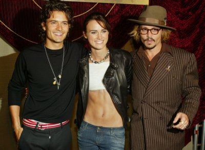 The cast of Pirates of the Caribbean The Curse of The Black Pearl, L-R British actors Orlando Bloom and Keira Knightley along with star Johnny Depp, pose together at the films premiere at Disneyland in Aneheim, Califor