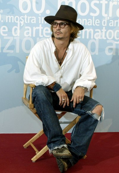 Johnny Depp poses during a photo call at Venice Lido August 28, 2003.