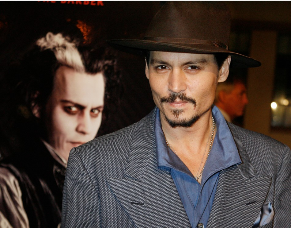 Johnny Depp poses next to a poster featuring him in character at a special screening of the DreamWorks Pictures film Sweeney Todd The Demon Barber of Fleet Street at Paramount Studios in Hollywood, California December 5, 2007.