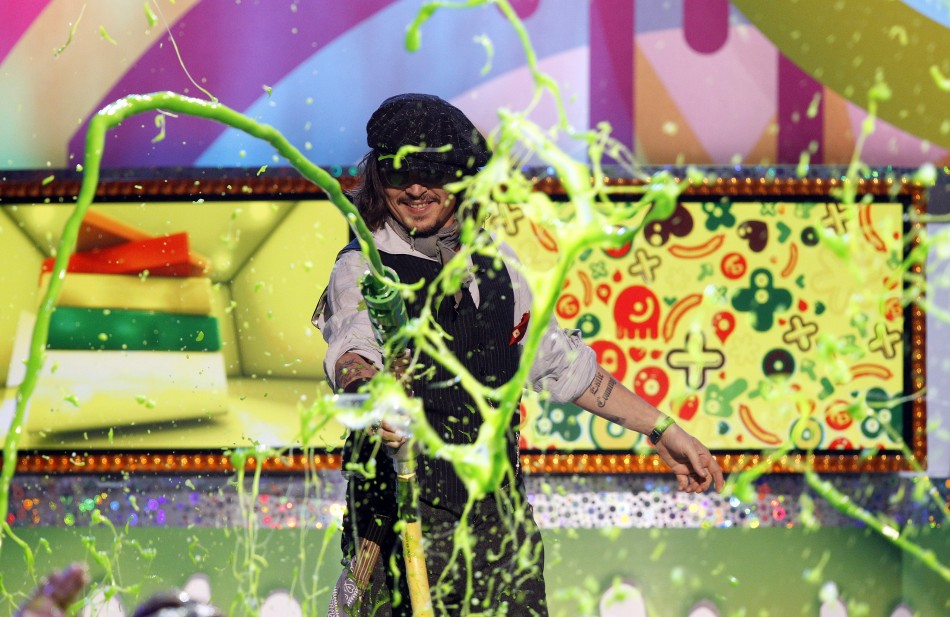 Johnny Depp, recipient of the Favorite Movie Actor award, slimes members of the audience at the 24th annual Nickelodeon Kids Choice Awards in Los Angeles April 2, 2011.