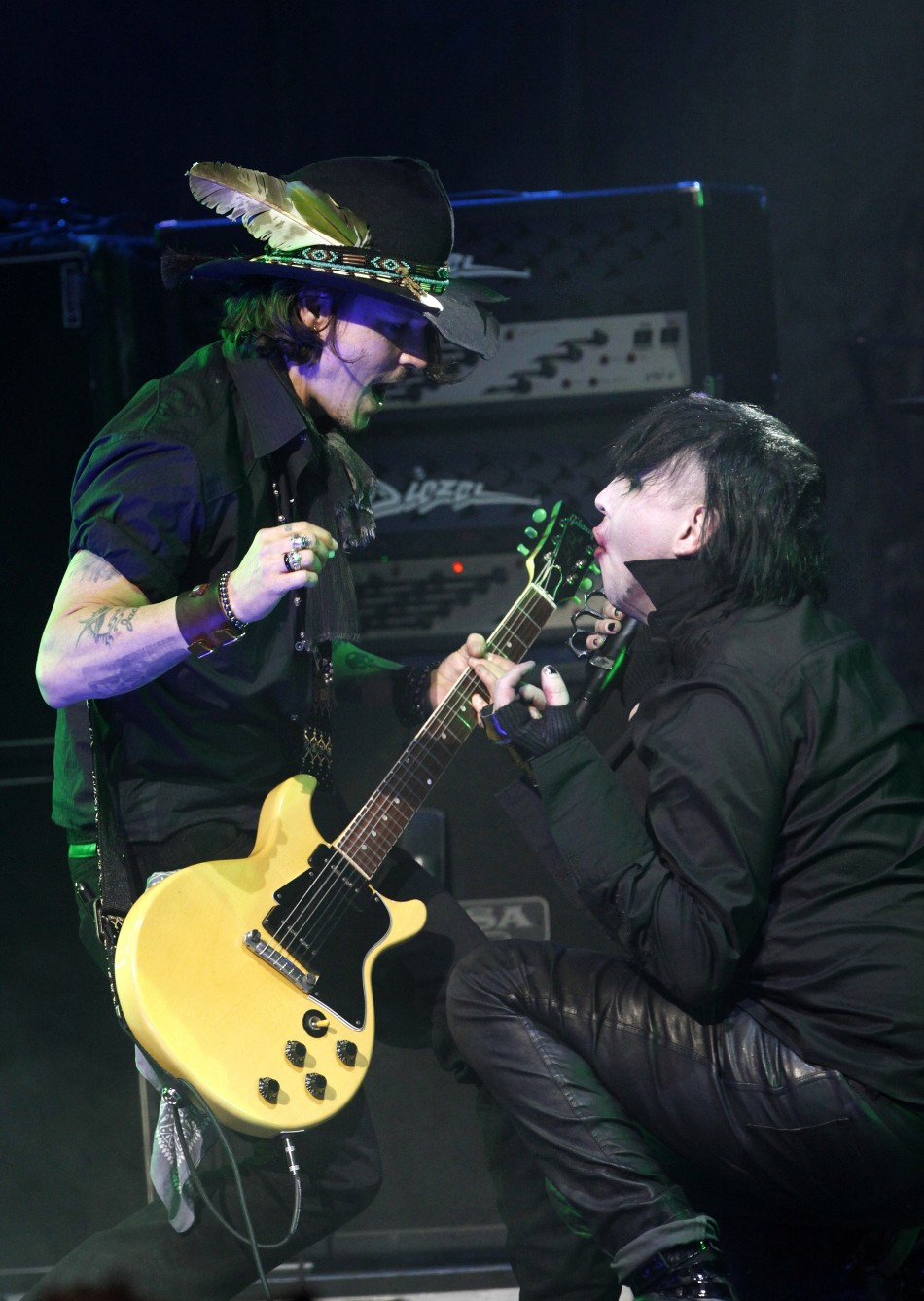 Johnny Depp L performs with musician Marilyn Manson at the 4th annual Golden Gods awards at Nokia theatre in Los Angeles, California April 11, 2012.