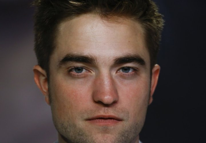 Heaven knows I'm miserable now. Newly single Robert Pattinson finds solace with Katy Perry and Leo DiCaprio