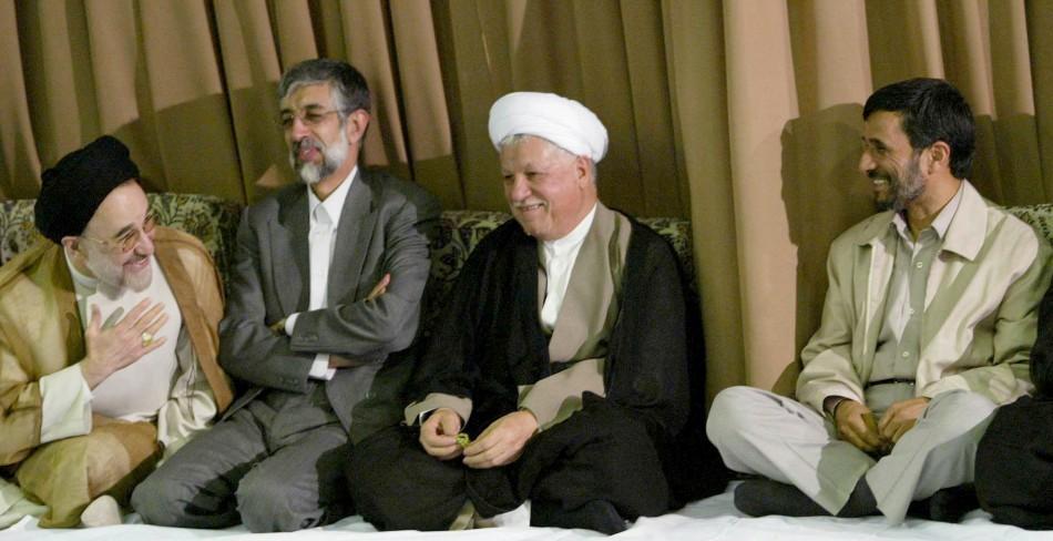 ran's former president Mohammad Khatami (L) greets President Mahmoud Ahmadinejad (R) as Akbar Hashemi Rafsanjani (2nd R) and Ghomali Haddad Adel smile during a meeting with Iran's Supreme Leader Ayatollah Ali Khamenei
