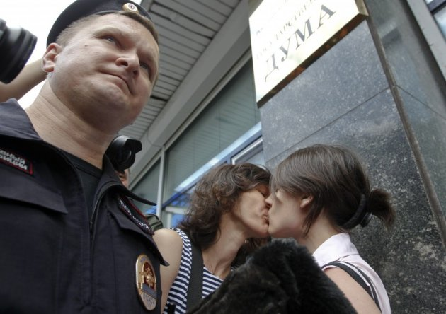 Gay rights activists kiss during a protest outside Parliament (Reuters)