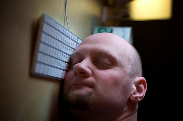 Man asleep at desk