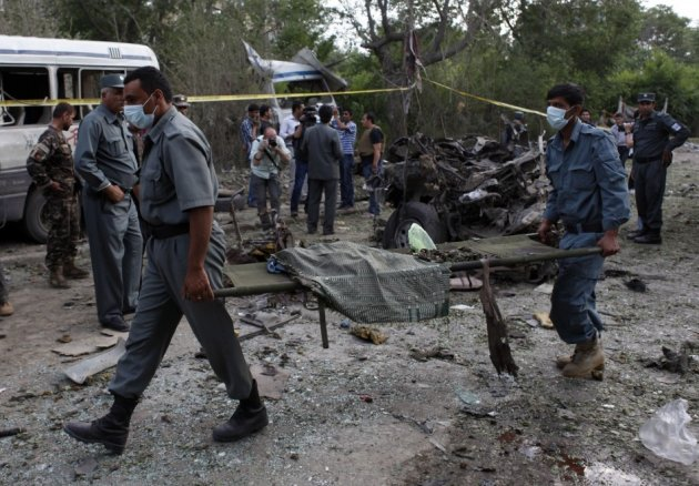 Emergency crews remove victims from Kabul supreme court bombing