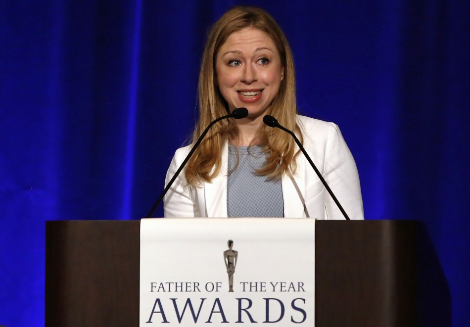 Chelsea Clinton introduces her father, former U.S. president Bill Clinton, as he is named 'Father of the Year'