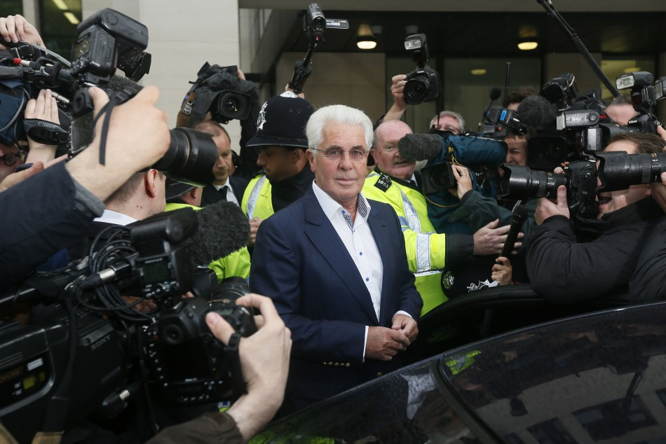 Max Clifford leaves after appearing at Westminster Magistrates Court in London last month (Reuters)