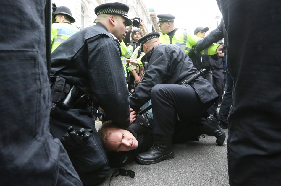 Police officers detain a protester demonstrating against the upcoming G8 summit (Reuters)