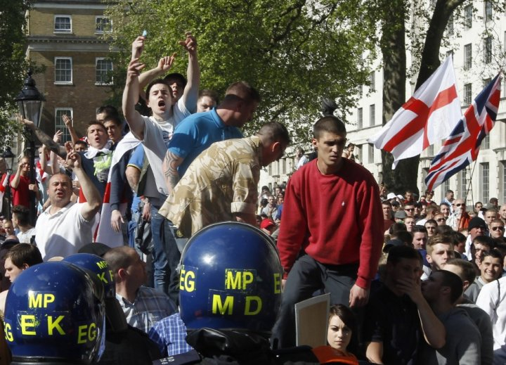 EDL demonstrators shout during a protest in Whitehall, organised following the recent killing of British soldier Lee Rigby (Reuters)