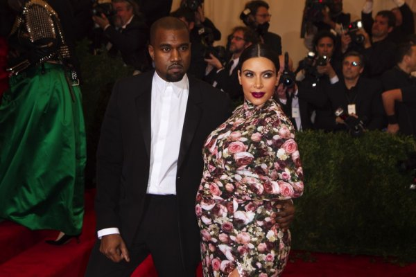 Kanye West and Kim Kardashian (R)
