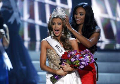 Miss Connecticut Erin Brady reacts as she is crowned by Miss USA 2012 Nana Meriwether during the Miss USA pageant at the Planet Hollywood Resort and Casino in Las Vegas, Nevada June 16, 2013.