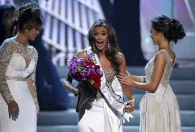 Miss Connecticut Erin Brady C reacts after being named Miss USA 2013 during the Miss USA pageant at the Planet Hollywood Resort and Casino in Las Vegas, Nevada June 16, 2013.