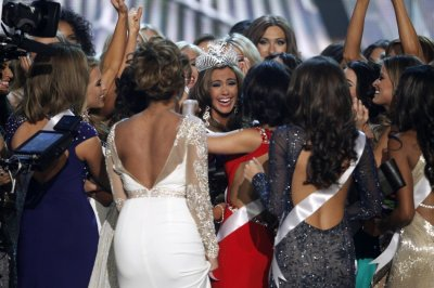 Miss Connecticut Erin Brady C is congratulated by other contestants after being crowned during the Miss USA pageant at the Planet Hollywood Resort and Casino in Las Vegas, Nevada June 16, 2013.