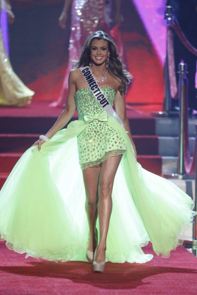 Miss Connecticut Erin Brady walks as she is introduced during the Miss USA pageant at the Planet Hollywood Resort and Casino in Las Vegas, Nevada June 16, 2013.