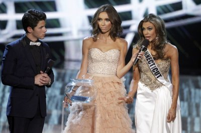 Miss Connecticut Erin Brady R responds to a question with show hosts Nick Jonas of the Jonas Brothers and Giuliana Rancic, co-anchor of E News, during the Miss USA pageant at the Planet Hollywood Resort and Casino in Las Vegas, Nevada June