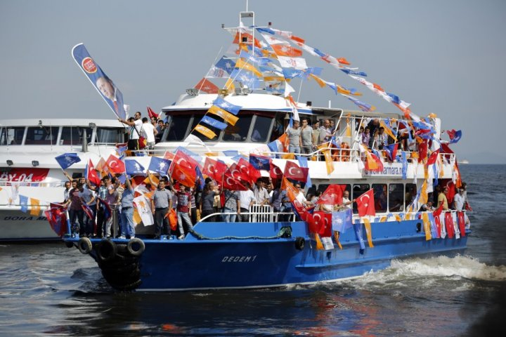 Supporters of Prime Minister Tayyip Erdogan's ruling AK party arrive by boat for a rally in Istanbu